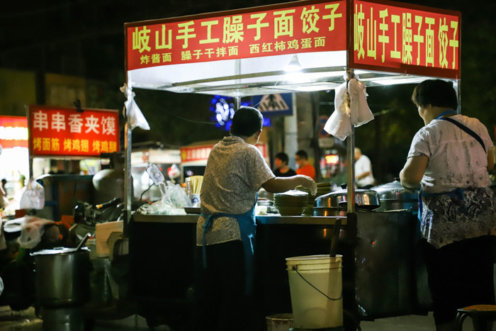 A street food market at night