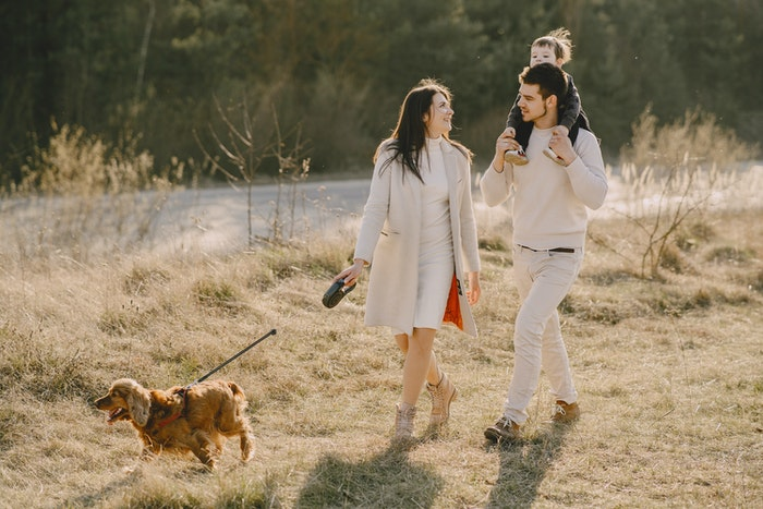 A family walking their dog