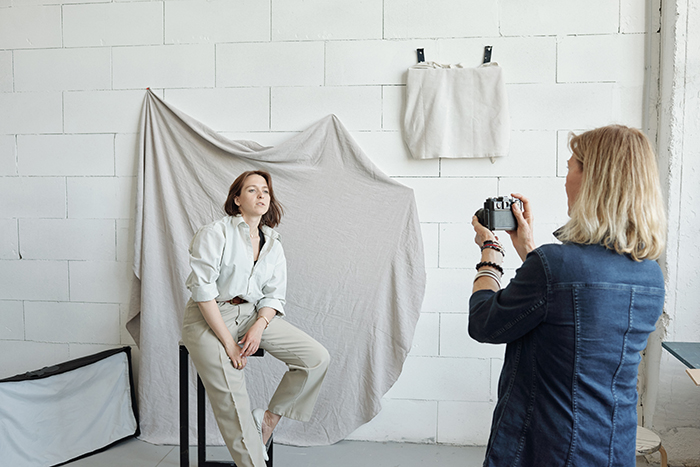 Photographer working with model.