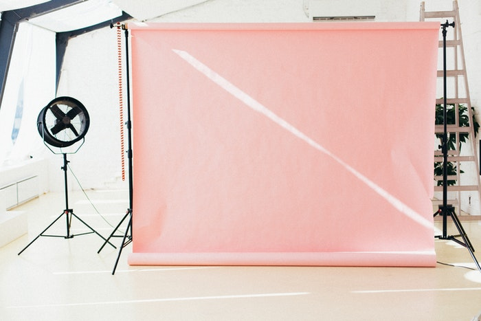 Pink backdrop in a home photo studio