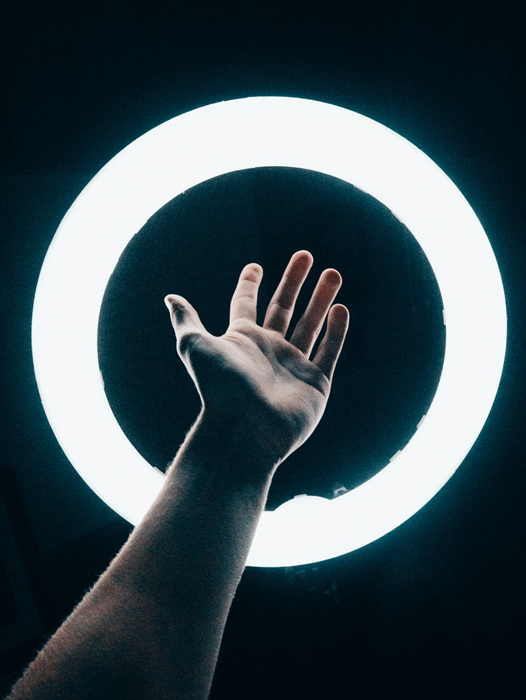 A hand on a ring light
