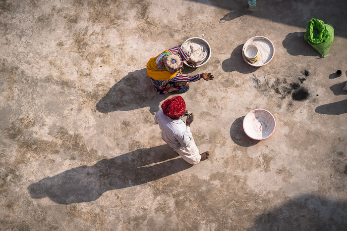 Looking down on Indian workers at Hawa Mahal in Jaipur. Original showing shadows. Photo by Jenn Mishra