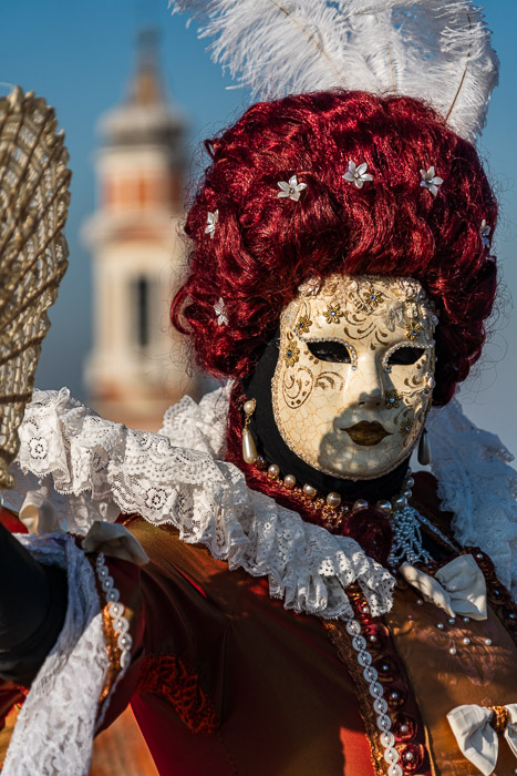 Shadow across face of masked model in Venice.