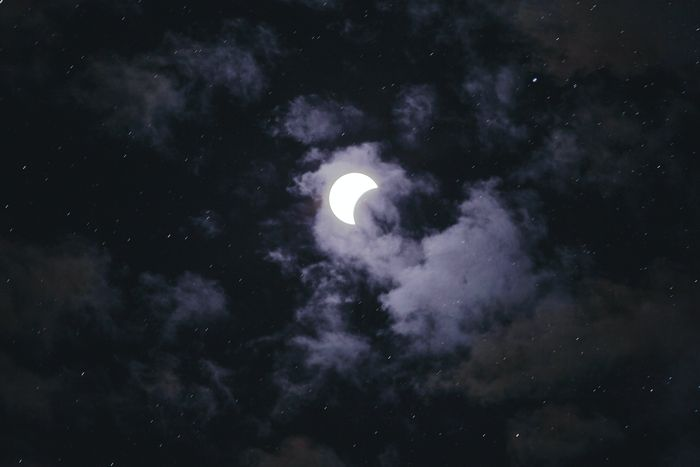 photo of the solar eclipse with clouds