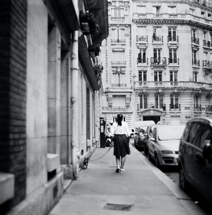 A black and white urban street scene