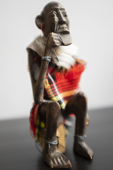 Blurry shot of a carved wooden tribal statue