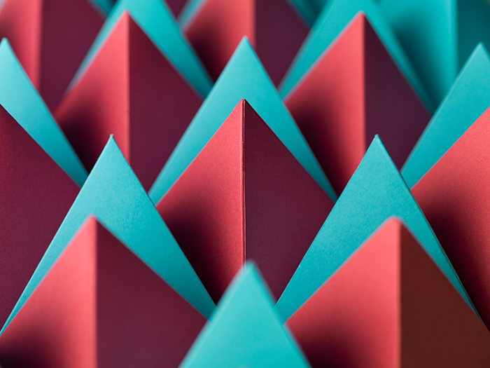 Abstract macro photography with colorful pyramids from paper.