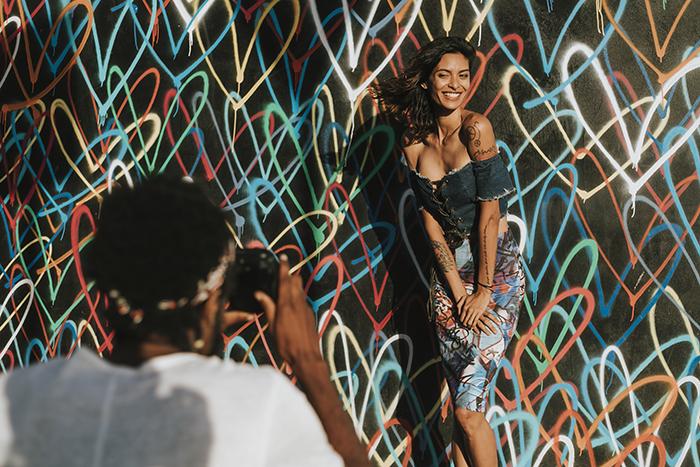 Beautiful model posing by a wall.