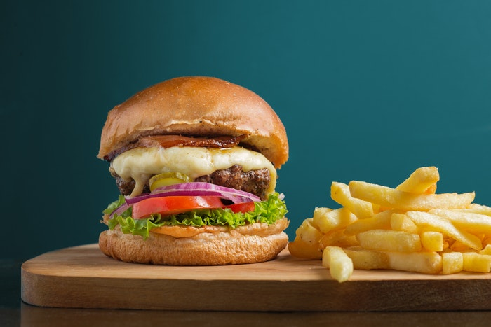 photo of a hamburger with a side of fries