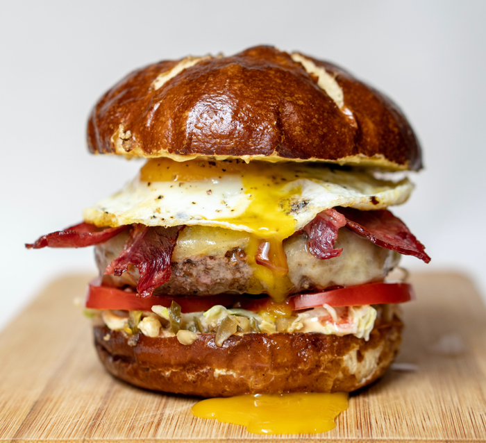 Close-up photo of a delicious burger on a rustic board