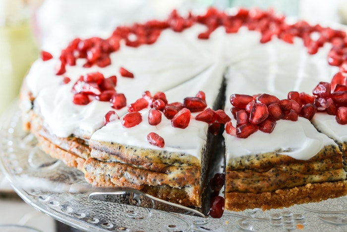 Close up of a frosted poppy seed cake