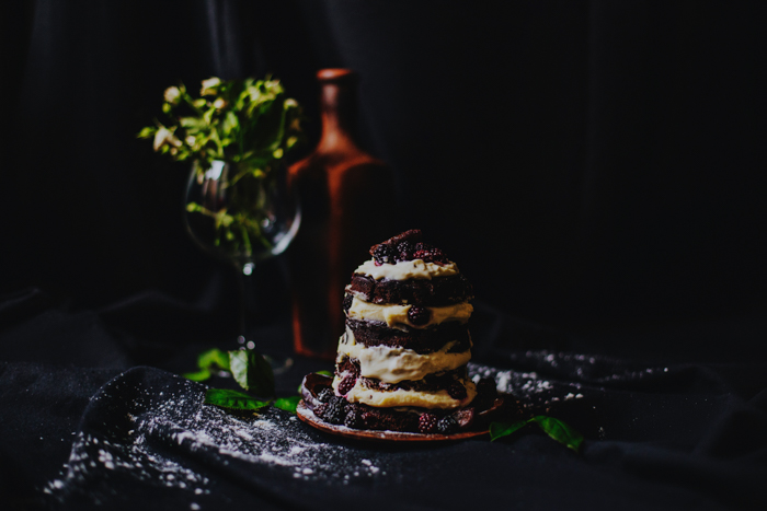 Photo of pancakes with fruits with a dark setting