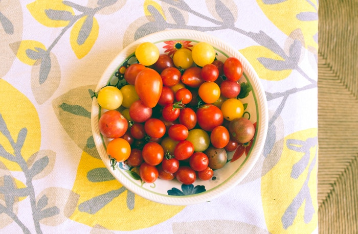 A bowl of tomatoes with diy background using linen