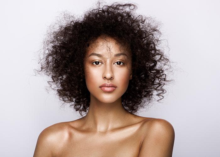 Fashion studio portrait with smooth skin retouch