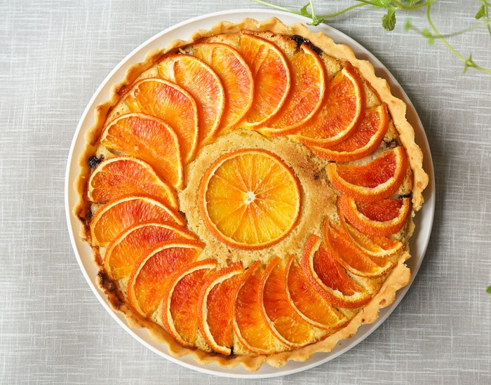 A flat lay photo of a delicious citrus tart