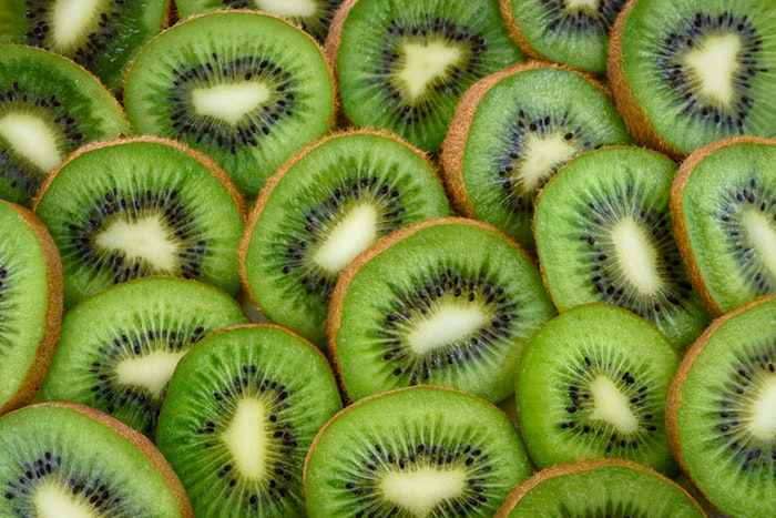 Close up fruit photography of many slices of kiwi