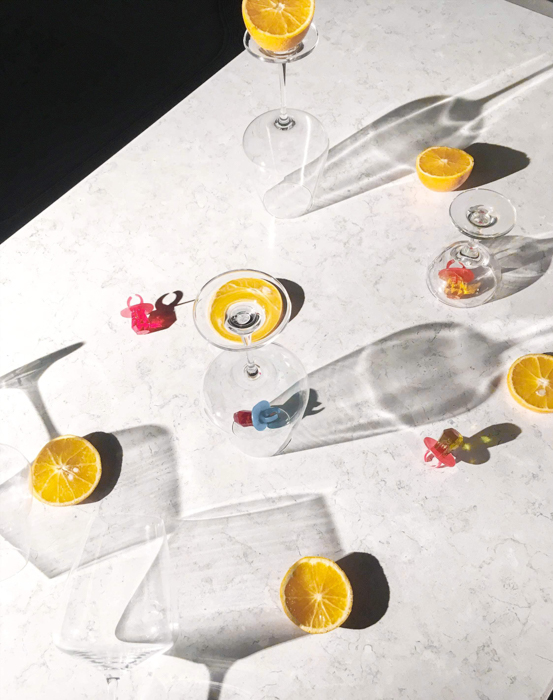 photo of a table with glasses and slices of lemon from dutch angle
