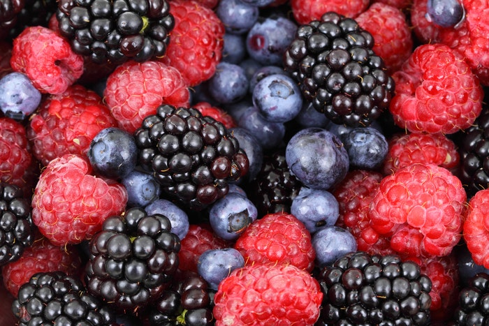 Close up fruit photography of raspberries, blueberries and blackberries