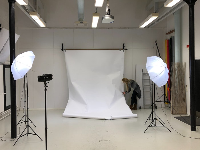 A photographer setting up a studio