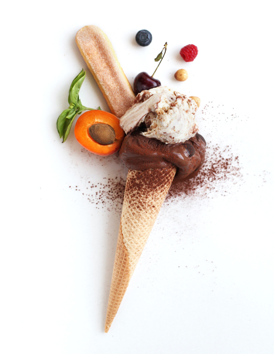 Flat lay photo of chocolate ice cream cone and ingredients
