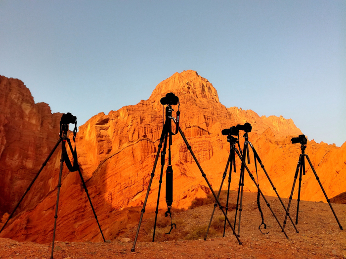Photo of cameras on tripods outdoors