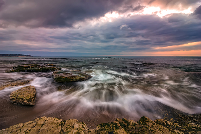Amazing long exposure seascape with motion blur and flowing wave.