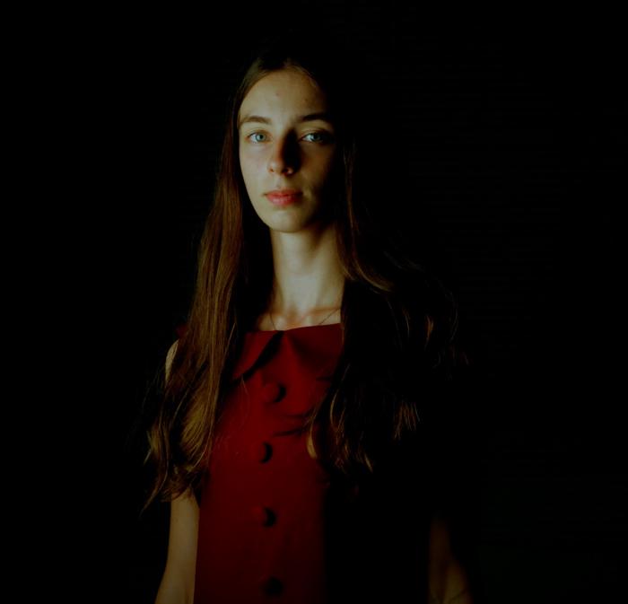 portrait photo of a woman in low key lighting