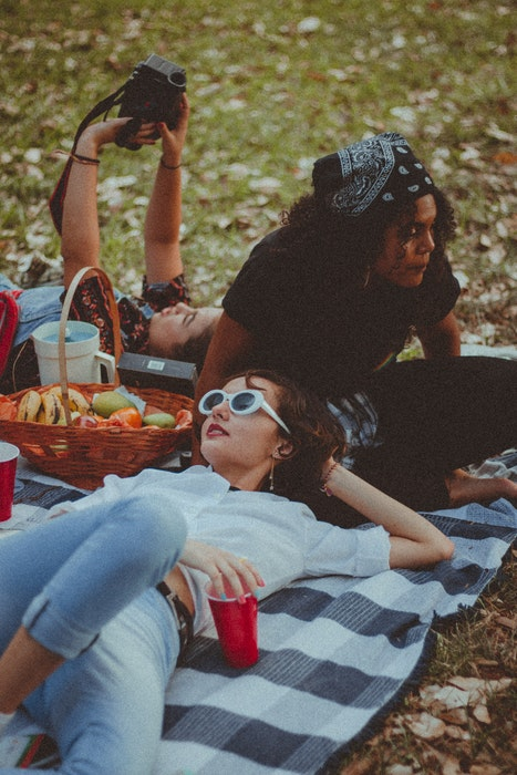 A group of girlfriends having a picnic