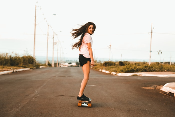 Stock photo of a girl on a skateboard