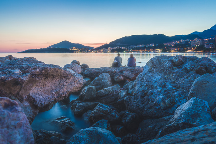 A rocky coastal scene at evening time