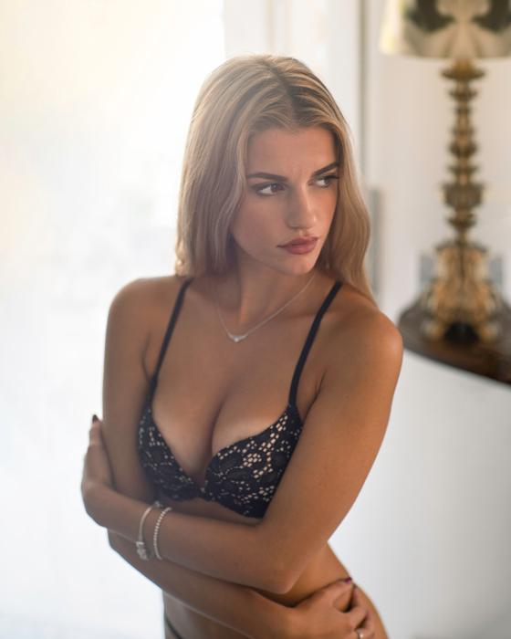 Boudoir image of a blonde girl in lingerie