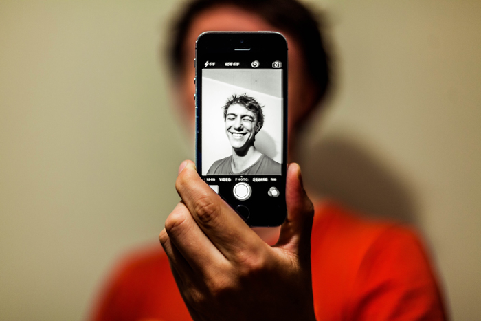 A man taking a selfie on a smartphone