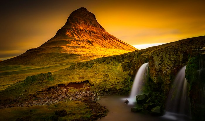 Beautiful long exposure landscape with mountain and waterfall