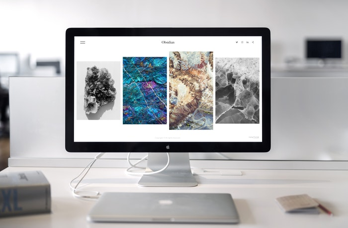 Desktop computer with stock photography images on the screen