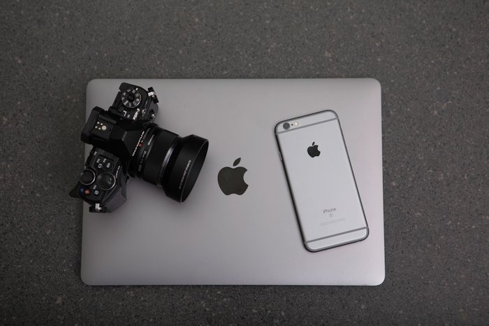 A DSLR camera, iPhone and a laptop