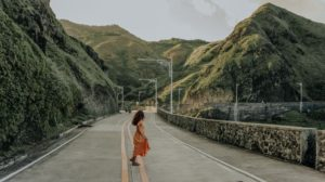 photo of a woman on a road edited in Lightroom