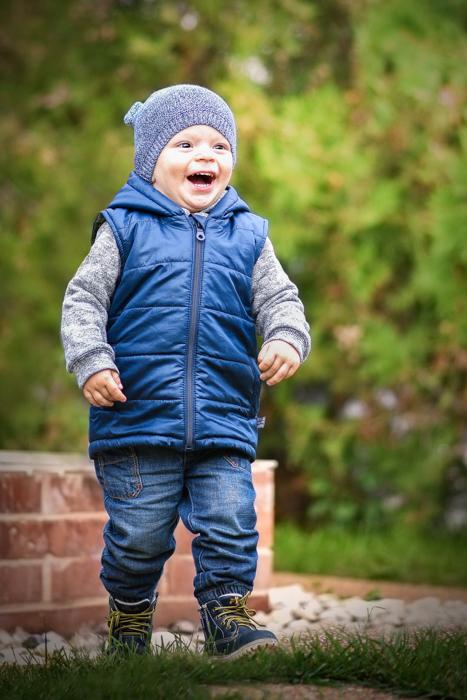 outdoor portrait of a running kid