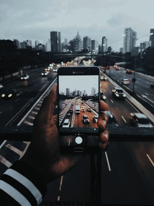 photo of someone taking a photo on an iphone