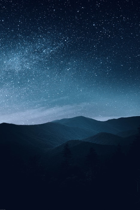 Stunning astrophotography shot of a star filled sky over mountains