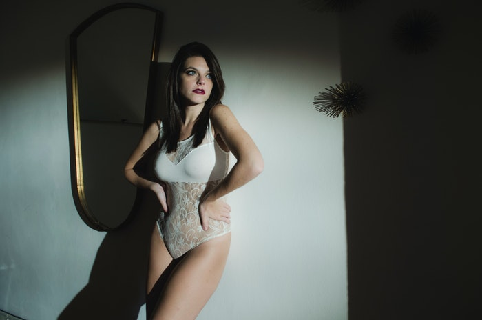 A girl posing for a bridal boudoir photoshoot