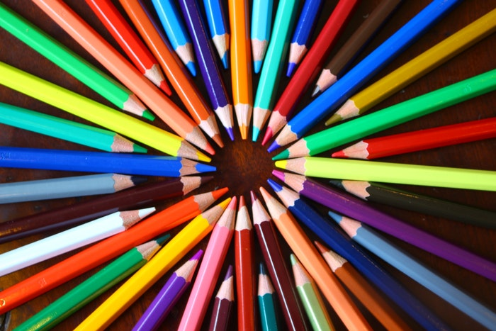 A circle of coloring pencils in various different bright shades