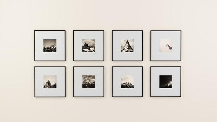 Framed artworks on a white wall