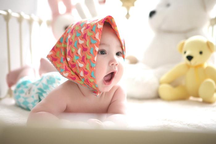 Cute newborn photo in a headscarf