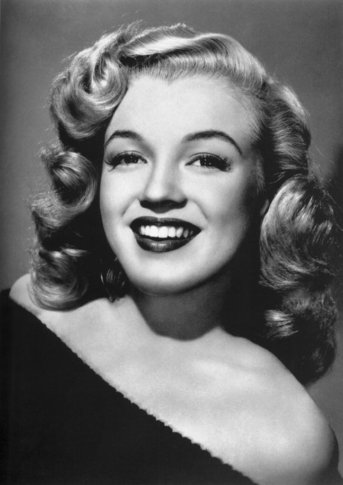 A black and white portrait of Marilyn Monroe
