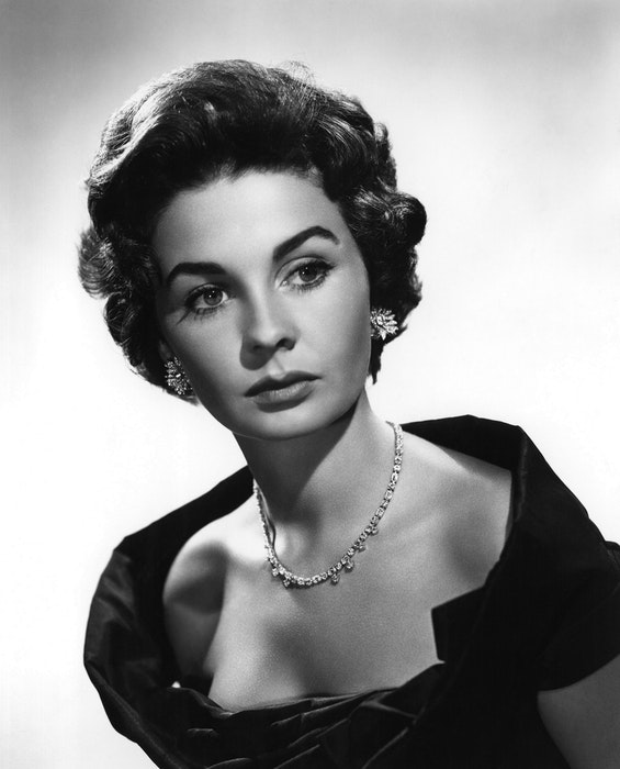 A black and white portrait of young Elizabeth Taylor