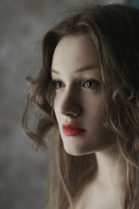 A close up profile portrait of a beautiful woman
