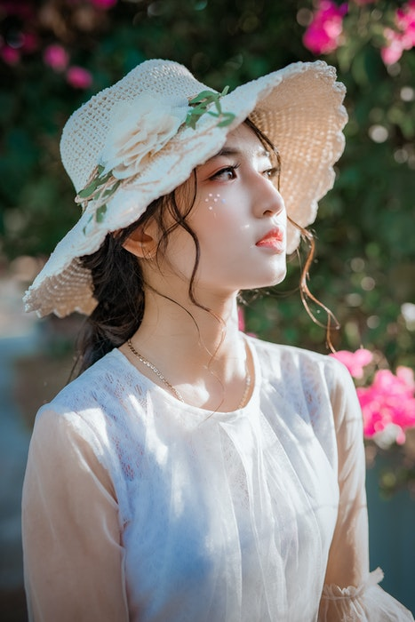 Profile photo of a woman in a summer hat