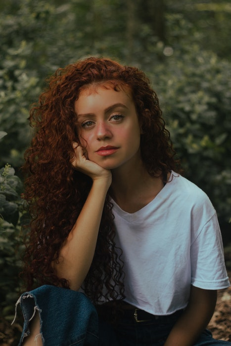 profile photo of a girl with red hair in a field