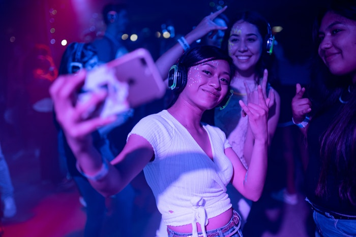 Girls posing for a selfie photo in a nightclub