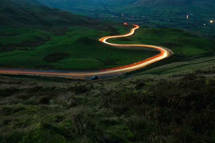 Light trails of traffic on a countryside road